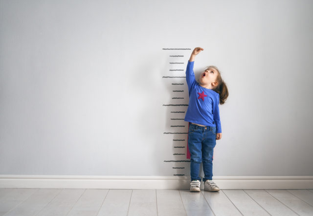 child-measure-height-tall-wall